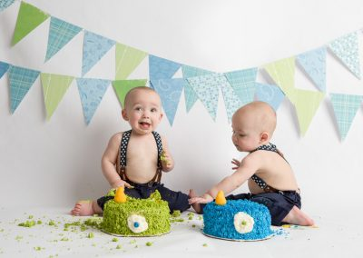 Twin Baby Boys eating cake at a Cake Smash photo session with Colleen Hight