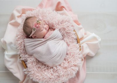 Baby girl in pinks and peaches during her newborn session with Colleen Hight Photography in Suwanee, Georgia.