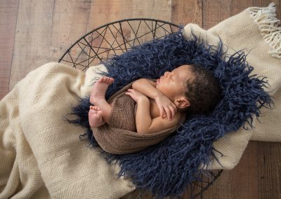 Baby boy in navy, cream, and brown tones during a newborn session with Colleen Hight Photography in Suwanee, Georgia