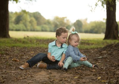 Siblings checking out acorns during their outdoor photo session
