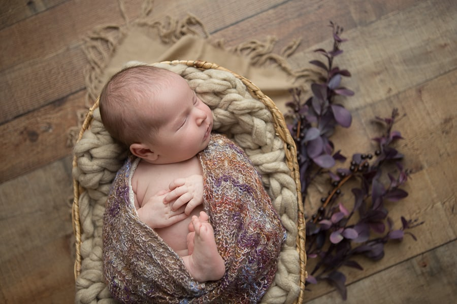 Newborn baby girl photo shoot with fall inspired colors and florals