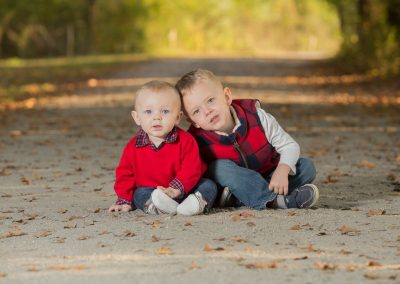 Blue-eyed brothers during a children's session by Colleen Hight Photography