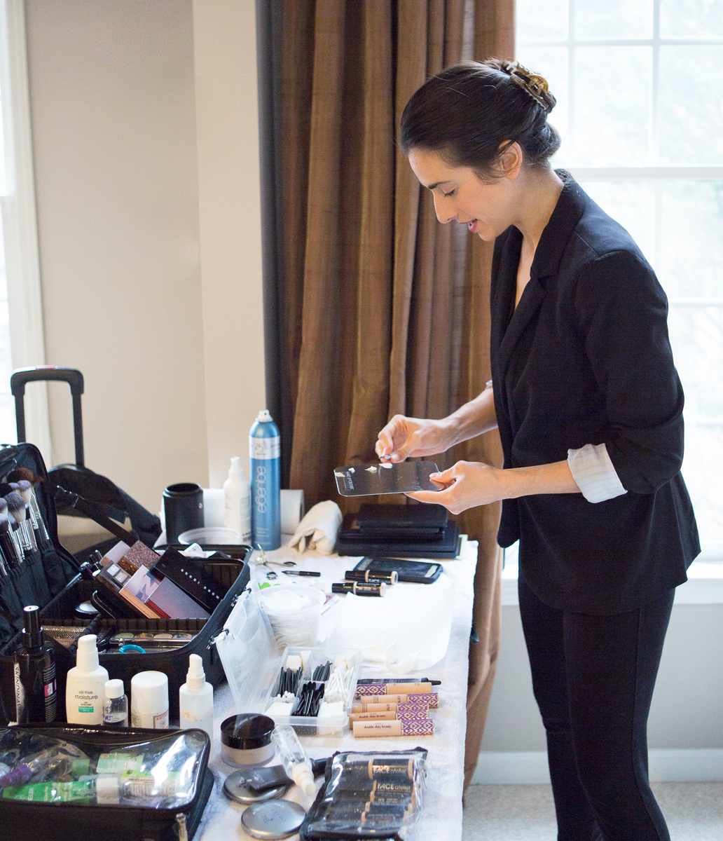 Makeup artist setting up tools and supplies before client session