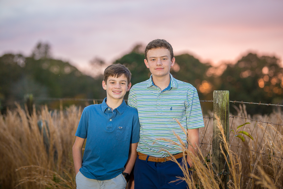 Teen brothers at sunset in field in Lawrenceville, Georgia