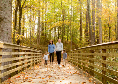 Family of four on Bridge in Suwanee, Georgia Park