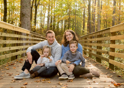 Family of four sitting on Bridge in Suwanee, Georgia Park