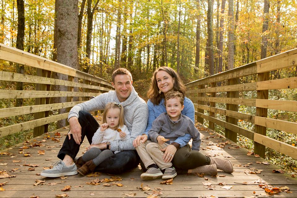 Family of four sitting on Bridge in Suwanee, Georgia Park
