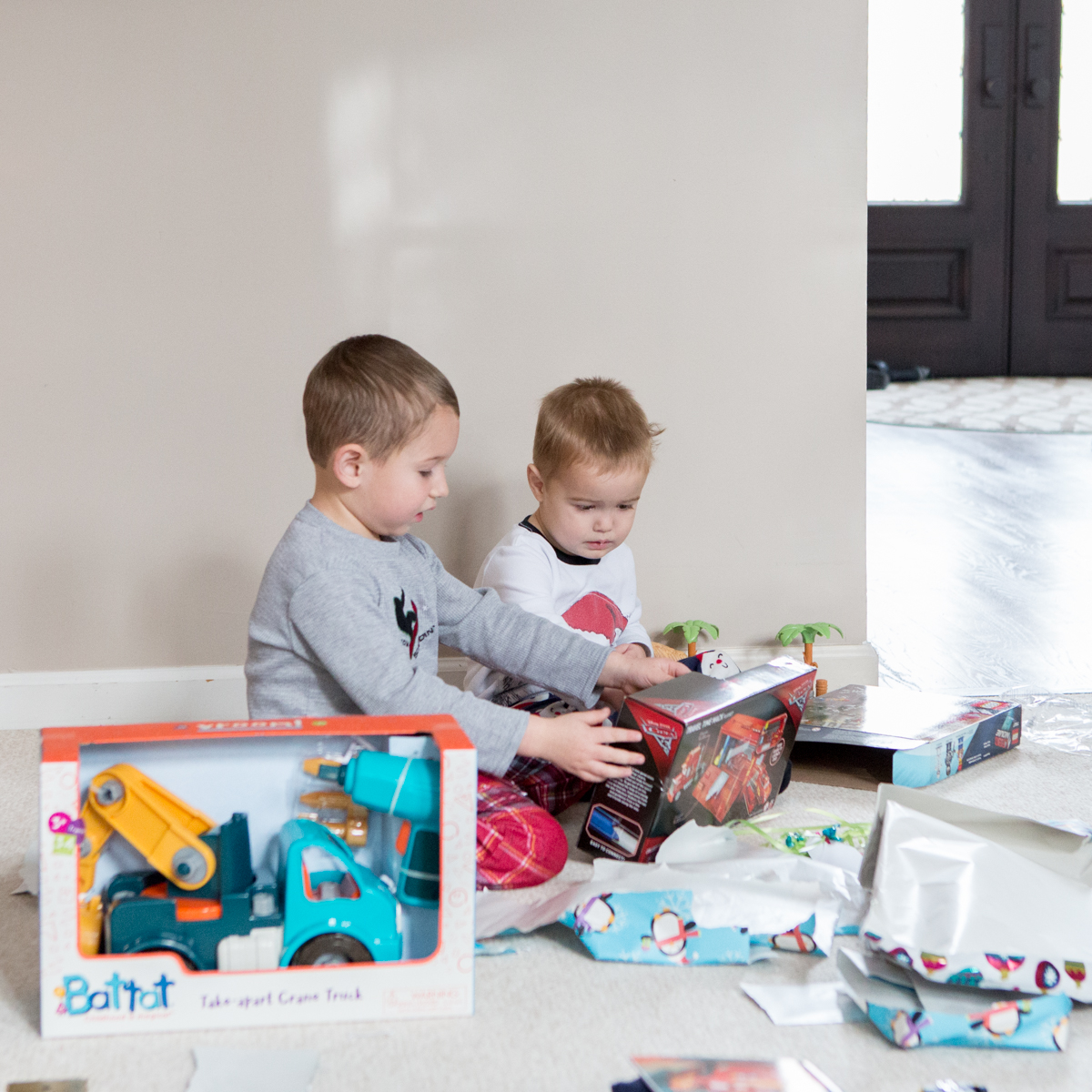 Photograph of young boy opening presents on Christmas morning