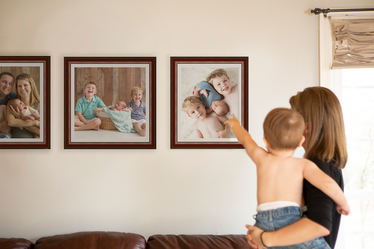 Display of photography wall art in family's living room